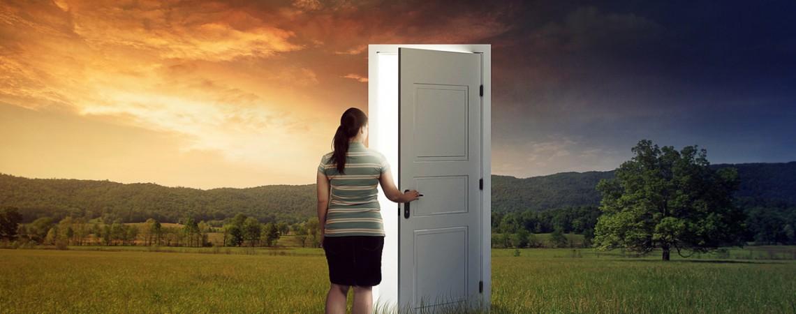 woman opening door